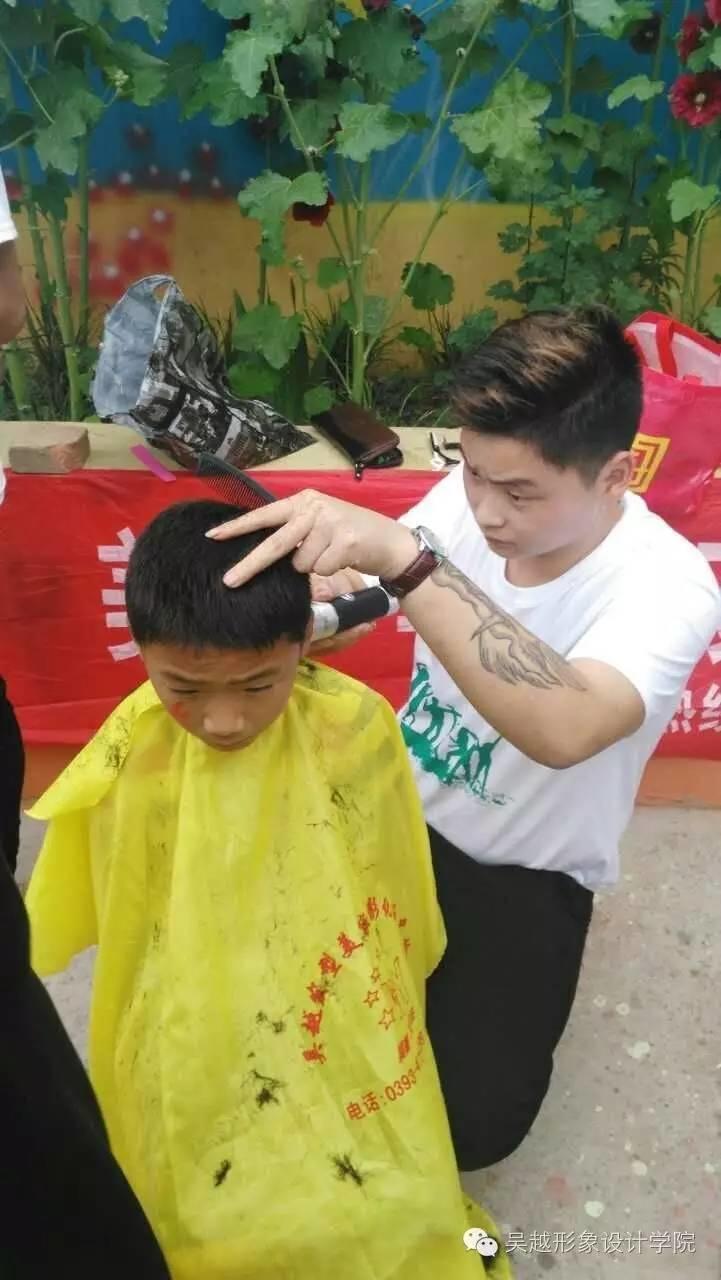 吴越学校六一儿童节关爱留守儿童义务理发活动